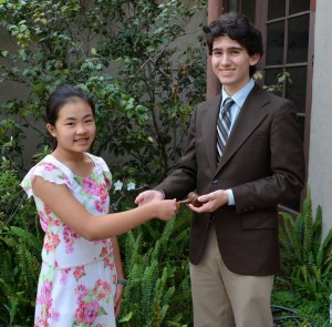 The Club Mentor passes the gavel to the club's first president.