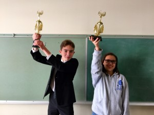 Alex (left), from the Orange County club, went undefeated in the Winter tournament, and took first place. The topic was whether state issued photo ID should be required to vote.